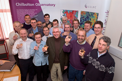 Chilbolton, ESA and SSTL staff celebrate the receival of the first signal by the Chilbolton antenna
