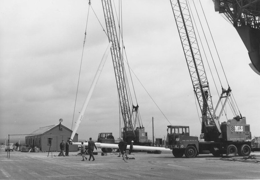 Feed legs are lifted into position by crane